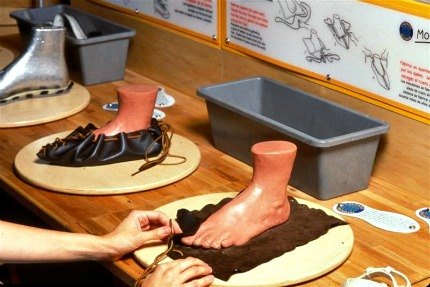 Creating shoes in the mock factory at the Brooklyn Children's Museum's Global Shoes
