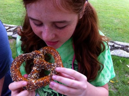Enjoying an everything pretzel from Callie's Pretzel Factory