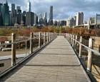 The bouncy Squibb Park Bridge connects the Promenade and Brooklyn Bridge Park