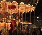 The carousel looks glamorous all lit up.