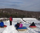 Snowtubers getting ready to race