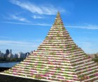 A rendering of a flower-filled Pyramid of Life in Socrates Sculpture Park