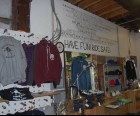 The shop stocks branded tees and hats, plus grips and frames