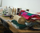 The sewing station is overflowing with materials