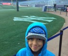 Next, we got to venture onto the field, where my ball-playing son<br /> was surprised at how hard the warning track actually is