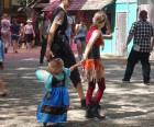 Children and adults dress in all sorts of costumes