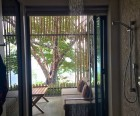The rain shower opens out onto your private patio for an outdoor shower expeience