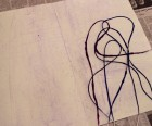 Lay string on paper
