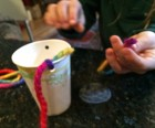 Tie yarn to cup