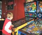 My son showing off his supple wrist skills at Modern Pinball