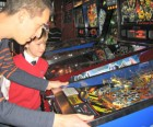 My son learning the tricks of the trade from pinball wizard and co-owner, Steve Zahler