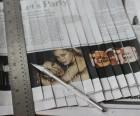 Cut newspaper into strips