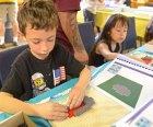 "Children building lego ships in ""drydocks"" at LA Maritime Museum"