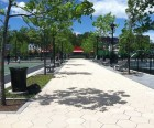 The pathway between the basketball courts and the playgrounds