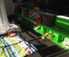 The separate toddler area feautures toys and manipulatives, soft carpeting<br /> for crawlers and lots of light