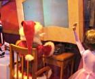 A mini Santa granting wishes at Macy's