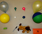 Gather like size and weight balls, balloons and toys for the experiment
