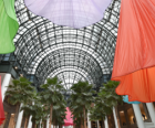 Swirls of color float overhead in the Winter Garden Atrium at Brookfield Place