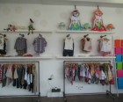 Clothing is also displayed on the walls