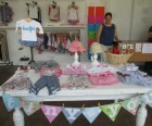 Tiny You Long Island City's main display table filled with gorgeous outfits and accessories