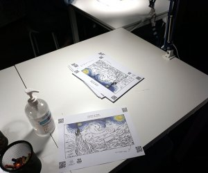 Table for coloring at Van Gogh: The Immersive Experience