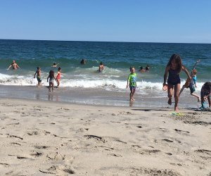 People playing in the surf at Jacob Riis Beach
