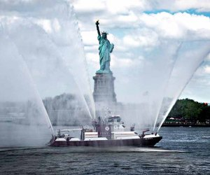 A New York City Fire Department vessel honors the Statue of Liberty with a water salute for Fleet Week. Photo courtesy of Fleet Week New York