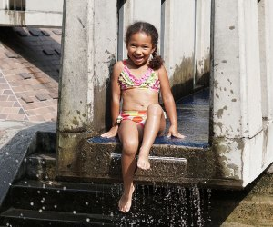 Play and splash at Ancient Playground in Central Park