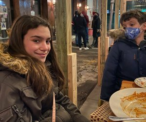 Kids at Bella Ciao's outdoor dining enclosure in NYC