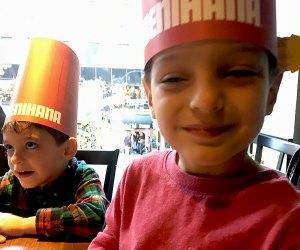 Two boys wear Benihana hats and enjoy a family-friendly New Jersey restaurant
