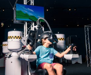 At the new Bionic Me exhibit, visitors can move a ball with their mind, manipulate a robotic arm, and explore how technology can provide camouflage and make you visible. Photo courtesy of Imagine Exhibitions