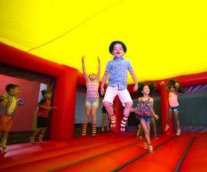 kids jumping in bouncy castle