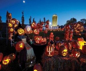 Stacked jack-o'-lantern's await at Wagner Farm Arboretums Halloween lights drive -thru