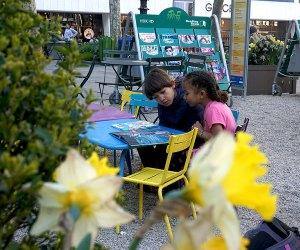 Two Girls enjoy Bryant Park's reading room