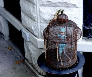 Skeleton in a cage decorates a stoop for Halloween