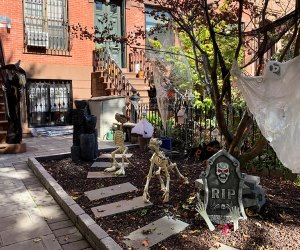 Halloween decorations with a ghost hanging from a tree