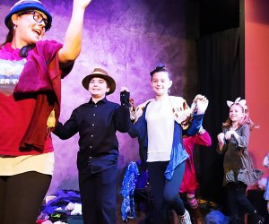 Children from the audience volunteer to become a character in The Greatest Story Never Told. Photo courtesy of the show
