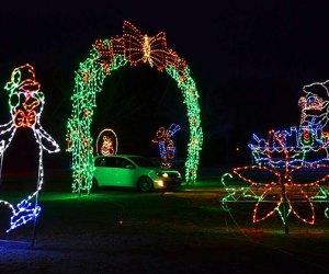 Cars drive past and through illuminated displays at the Skylands Stadium Christmas Light Show