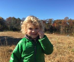 Child in a field at Washington Lake Park