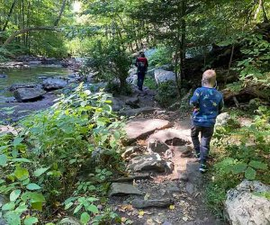 A family hikes alongside the Black River in New Jersey