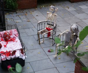 Two skeletons rock with a haunted cradle nearby