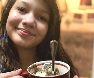 Smiling girl holding s'mores mug cake