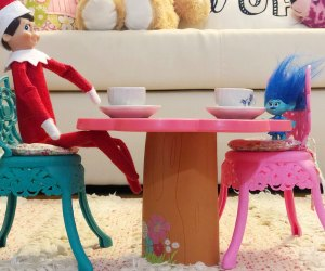 Elf on the Shelf has a tea party with other dolls