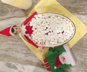 Elf on the Shelf takes a dip in a marshmallow bath