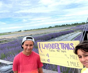 kids pose in front of the lavender trails sign