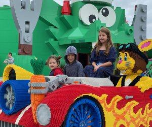 Kids sit in a car at Legoland New York