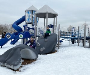 Kids on snowy playground at Liberty State Park