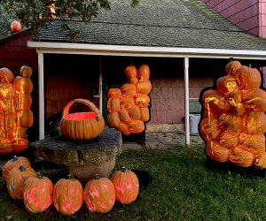 Witches' boil up a brew in a jack-o-lantern cauldron. halloween great jack o lantern blaze