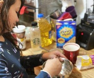 Girl mixes together a mug cake