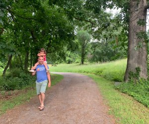 Father carrying daughter on shoulders in rockefeller state park